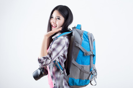 Beautiful woman traveler - on white background 版權商用圖片