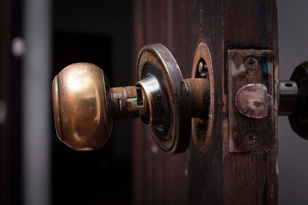 door knob: Broken door knob on wooden door