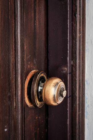 knob: Broken door knob on wooden door