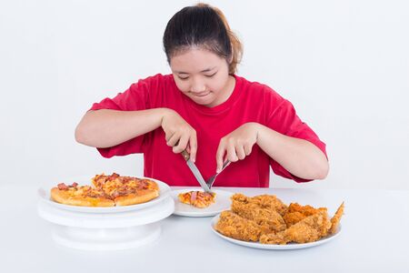 eating fast food: Woman with fast food - High calories food concept Stock Photo
