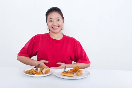 glut: Woman with fast food - High calories food concept Stock Photo