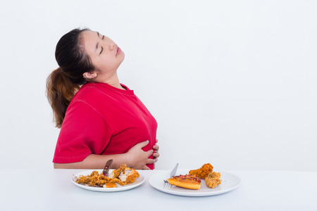 unsatisfied: Woman with fast food - High calories food concept Stock Photo