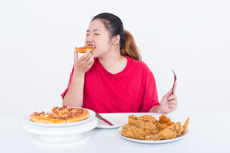 Woman with fast food - High calories food concept 写真素材