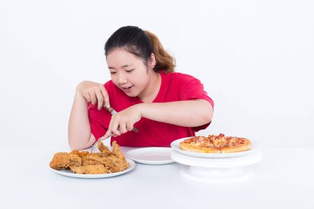 the calories: Woman with fast food - High calories food concept Stock Photo