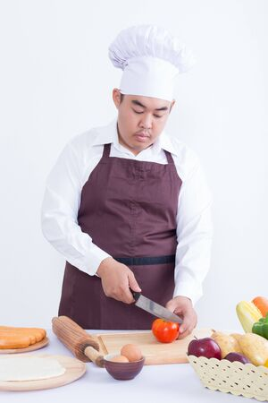 asian cook: Male chef cooking concept - on white background Stock Photo