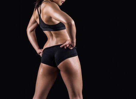 sexual anatomy: Beautiful body of  fitness woman - dark background