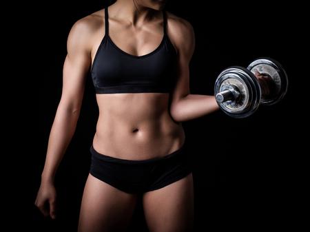 sexual anatomy: Beautiful body of  fitness female - dark background