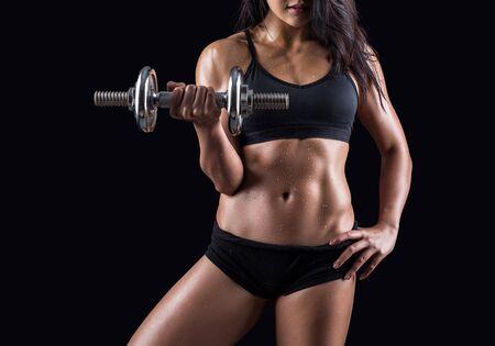 Beautiful body of  fitness female - dark background