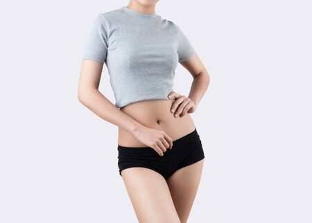 Beautiful slim woman body - isolated on white background Stock Photo