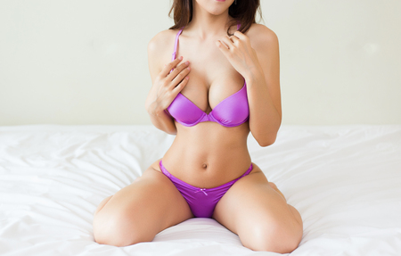 beautiful slim body of young woman in lingerie