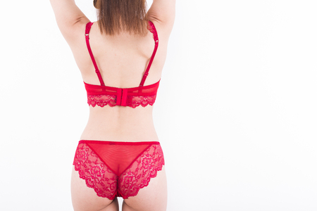 sexy young woman model in sexy red lingerie isolated on white background