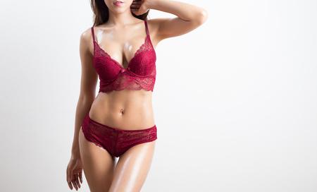 Schöne schlanke Frau im Studio - isoliert auf weißem Hintergrund Standard-Bild