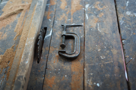 Close up vintage table saw and c clamp (Circular saw) 版權商用圖片