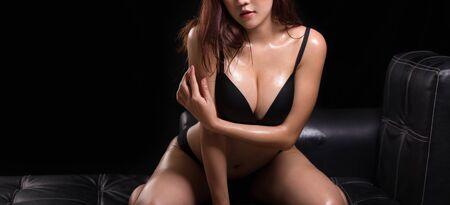 Beautiful slim body of woman in studio - ioslated on black background