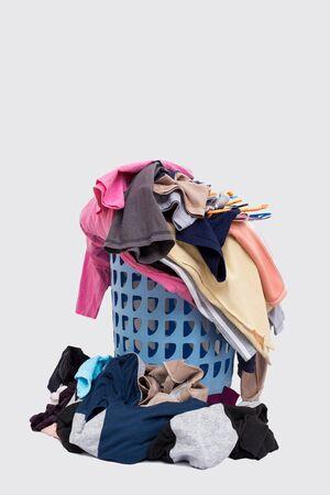 Basket with laundry isolated on white background.