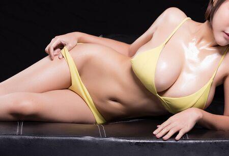 sexy young woman model in sexy bikini. Isolated on black background 版權商用圖片 - 134726670