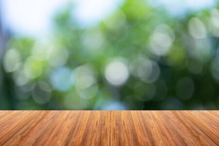 Wooden board on Blurry Bokeh background For display products.