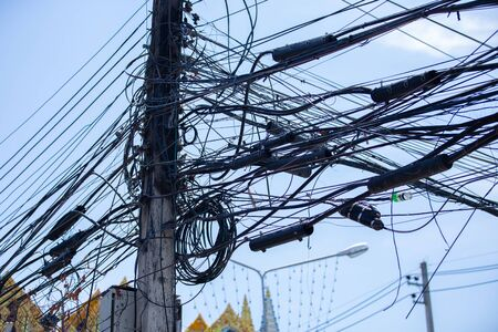 2 May 2020: A tangle of cables and power wires in Chiang Mai, Thailand, Asia Foto de archivo