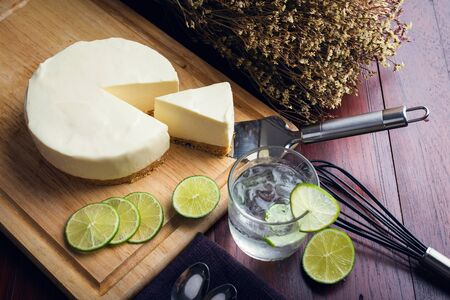 Ice box cheese cake with lemon and Lemon juice on wooden table. Homemade cheese cake.