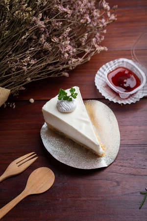 Ice box cheese cake with strawberry jam on the table. Homemade cheese cake.