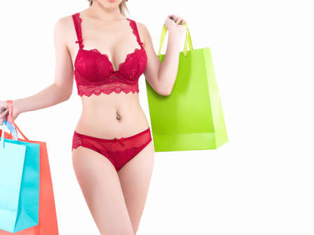 Young beautiful Sexy Asian woman wearing elegant lingerie with shopping bags - isolated on white background Foto de archivo
