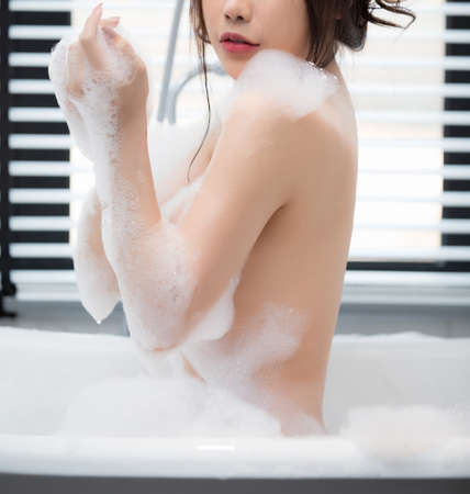 Sexy young woman model take a bath. Sexy woman model in  bathtub bathing.