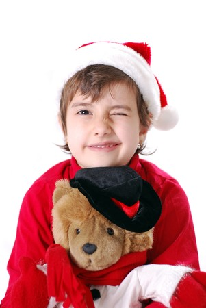 Winking Christmas Kid with hat and teddy bear Stock Photo - 3968033