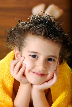Kid with a yelow towel sincere view Stock Photo - 3968048