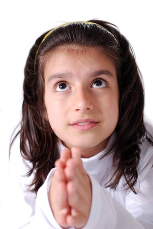 looking upwards: A young teenaged girl praying and looking upwards with expectance from above