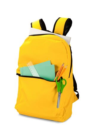 Backpack with different school stationery. Isolated on white background. Back to school concept photo.