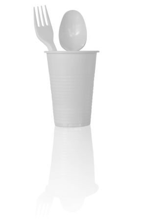 Plastic Cup with Spoon and Fork in It. Isolated on White Background.