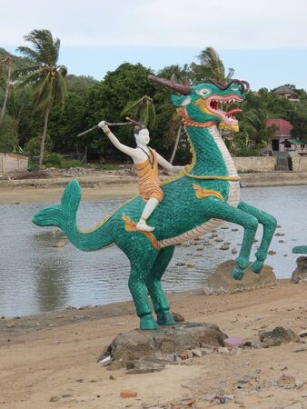 divinity: Buddhist divinity on dragon statue