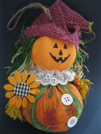 Halloween Jack O lantern doll black background photo