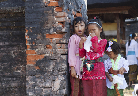 BALI, INDONESIA - AUGUST 28,2012: Children on the national Balinese ceremony