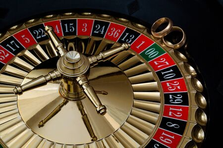 Wedding gold rings on the roulette wheel