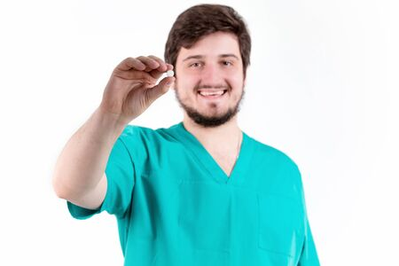 Doctor man holding tablet on white background in Studio. Фото со стока