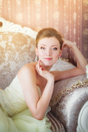 luxurious sofa: Beautiful bride lying on a luxurious sofa.