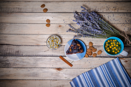 pits: herbal tea, a bouquet of lavender chocolate cake and apricot pits loose Stock Photo