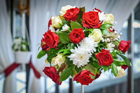 happier: Bright bouquet with red roses as the decoration of the celebration
