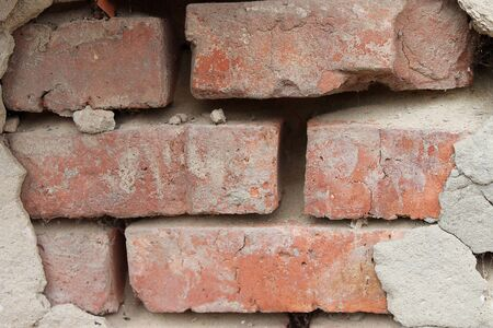 crumbling: background depicting a brick wall with crumbling plaster Stock Photo