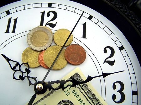 cash cycle: Watches and coins of euro. close-up Stock Photo