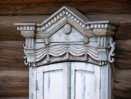 buryatia: The windows with beautiful architraves in old wooden house. Ulan-Ude. The Republic of Buryatia.