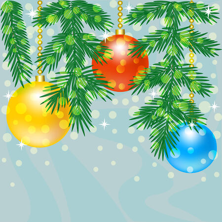 Christmas tree branch with baubles on blue background