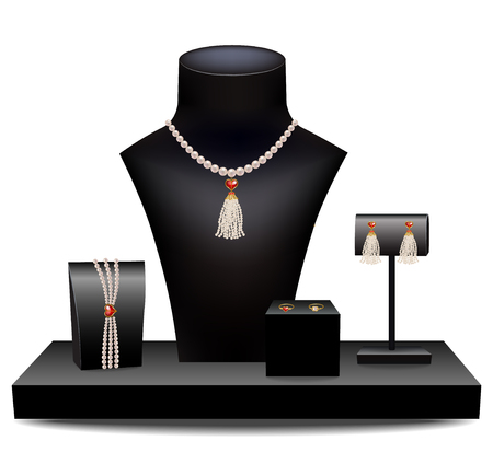 earrings: Pearl necklace, bracelet, earrings and ring on mannequins
