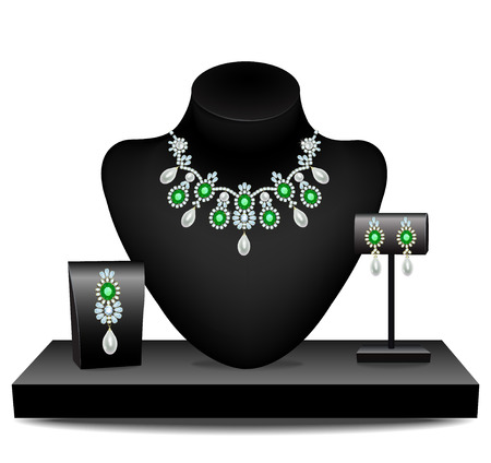 earrings: Necklaces, earrings and brooch with diamonds and emeralds on mannequins