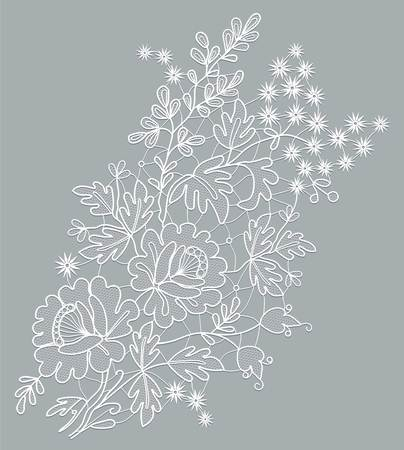 white lace floral element on a gray background