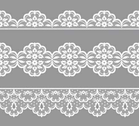 Set of white lace borders on a gray background
