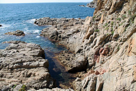 rocky coast of the mediterranean sea Beautiful view of rocks with blue sea with waves under sunshine sky. Mediterranean Sea.
