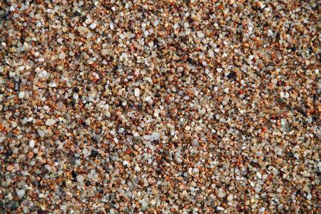 sea sand as background. pebble stone background.