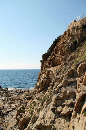 The sea. beautiful rocky coast of the sea with waves, horizon and blue sky. vertical. Mediterranean Sea Banque d'images
